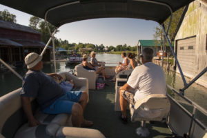 friends and family enjoying a pontoon boat ride on the inland waterway