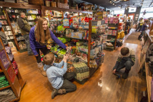 smiling children picking out toys at grandpa shorters