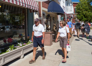 shopping couple window shopping on main street in harbor springs