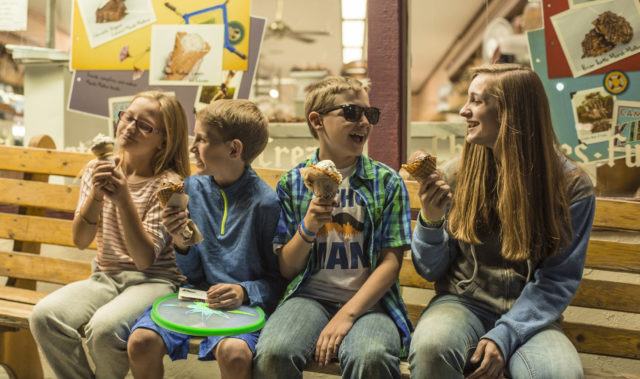 kids eating chocolate ice cream in waffle cones at Kilwin's