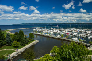 scenic view of petoskey waterfront with sailboats on a sunny day