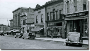 historic photo of main street in petoskey with vintage cars