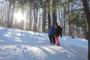 smiling friends snowshoeing on trout creek trails